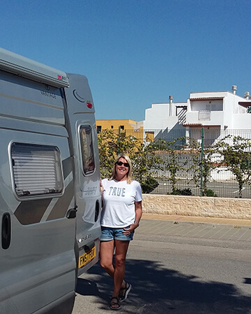 Jane Naylor next to one of their motorhomes.