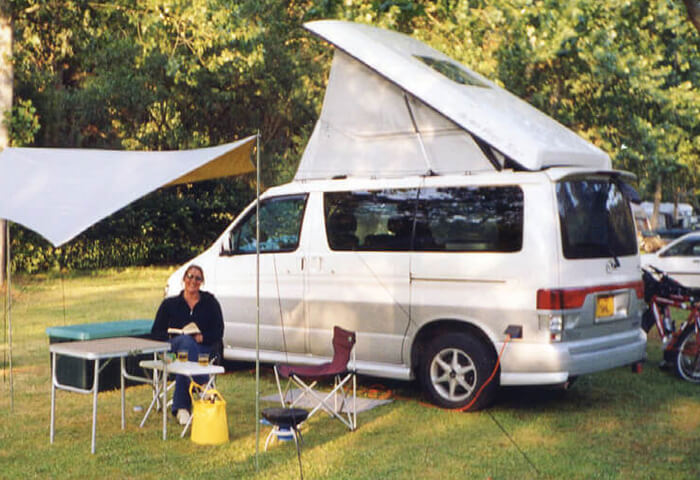 Jane Naylor with a pop top motorhome.